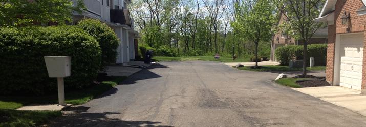 commercial asphalt repair before photo